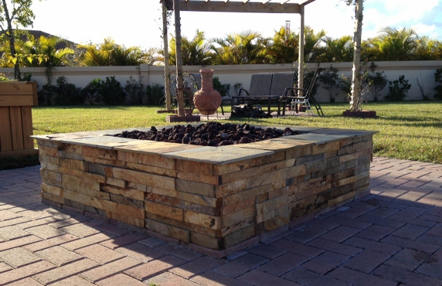 Stacked stone fire pit by Norstone