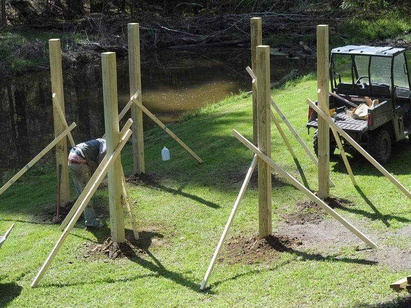 Fire pit swing set construction: Setting Uprights