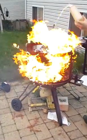 Pouring Gasoline To Light A Fire Pit